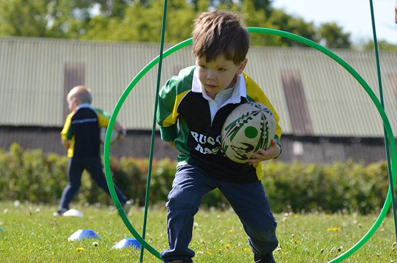 little boy enjoying a rugby training